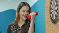 Young female working out, lifting dumbbells, staying fit healthy, click for HD Stock Footage