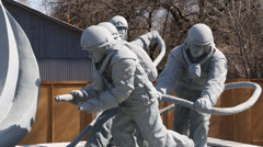 Memorial statue to lost firefighters of chernobyl nuclear accident in ukraine Stock Footage