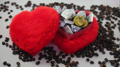 Red heart shape candy box and spilled coffee beans. Stock Footage