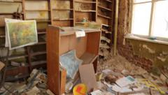 pan of interior of abandoned school house near chernobyl nuclear accident - stock footage
