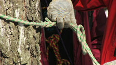 Man tying a knot in a climbing rope Stock Footage