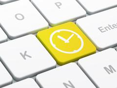 Time concept: Clock on computer keyboard background Stock Illustration