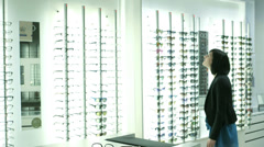 MLS Male and Female Customers Browse Optician Shop Stock Footage