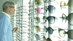 MS Male Customer browses Optican shop Stock Footage