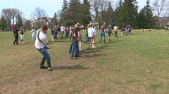 College students play tug of war on campus Stock Footage