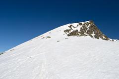 alpinist towards the summit - stock photo
