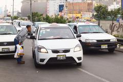 Man asking taxi for fare in lima, peru Stock Photos