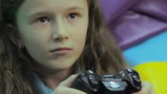 Happy child playing console game, time wasting, game addiction, click for HD - stock footage