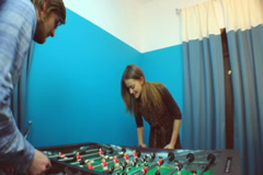 Cute couple plays table football, entertainment, dating, click for HD - stock footage
