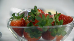 Shifting focus from strawberries to the chocolate granules - stock footage