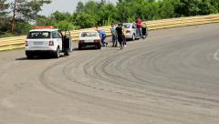 Mechanics crew, safety marshal check race car breakdown on track Stock Footage