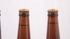 Conveyor Bottles of beer with drops isolated on white background Stock Footage