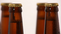 Bottle of beer with drops isolated on white background Stock Footage