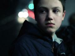 Pensive teenager riding bus through the city at night NTSC Stock Footage
