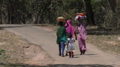 P03503 People Walking in India Carrying Baskets on Head - stock footage