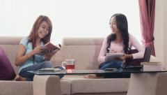 4of13 asian girls using ipad, phone and studying at home Stock Footage