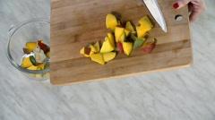 Putting mango into blender Stock Footage