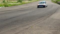 Sport cars chasing leader leaving rubber traces on asphalt track Stock Footage