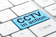 Privacy concept: CCTV In action on computer keyboard background - stock illustration