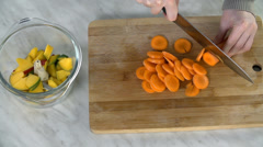 Slicing carrots into pieces Stock Footage