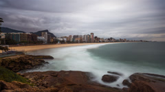 Morning time-lapse of the Impanema Beach from a rock outcropping. Stock Footage