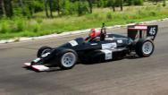 Stock Video Footage of Formula one driver taking sharp turn at the race track