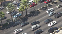 Aerial view panoramic street traffic car crowded pass tropical stop wait sunny  Stock Footage