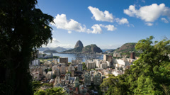 Time-lapse between trees overlooking Rio of Sugarloaf Mountain. Stock Footage