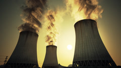 Stock Video Footage of Nuclear power plant steaming cooling towers. Air pollution power station.Sunset