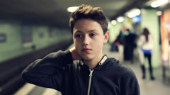 Young teenager waiting for metro train on subway station HD Stock Footage