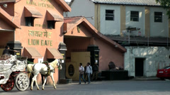 India Maharashtra District Mumbai 057 Lion Gate, horse and cart - stock footage