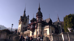 Tourists at Peles castle, visiting 19 th century Neo-Renaissance style castle - stock footage