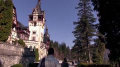 Tourists at Peles castle, visiting 19 th century Neo-Renaissance style castle Stock Footage