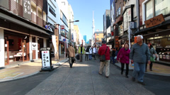 Tourists visit shopping street Asakusa can see Tokyo Skytree Stock Footage