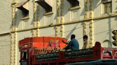 India Maharashtra District Mumbai 058 street scene, workers on a truck Stock Footage