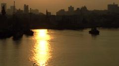 India Maharashtra District Mumbai 065 setting sun reflected on the water Stock Footage