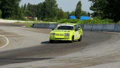 Race vehicles rushing in extremely hot pursuit on track curve Stock Footage