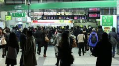 Commuters walk through in Shinjuku busiest station Stock Footage