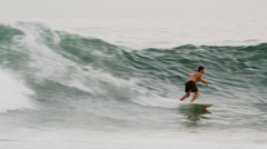 Close daylight shot of surfer riding a wave off the coast of Rio de Janeiro, Stock Footage