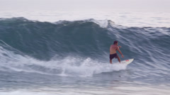 A surfer catches a wave on a short board off the coast of Rio de Janeiro, - stock footage