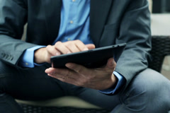 Businessman hands working on tablet computer NTSC Arkistovideo