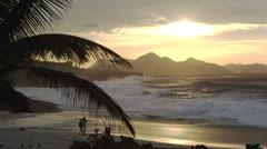 Couple on Ipanema beach at sunset Stock Footage