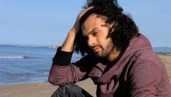 Handsome sad italian man in front of the ocean Stock Footage