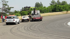 Broken racing car evacuated from track by truck, time-lapse, click for HD Stock Footage