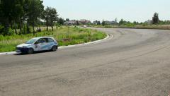Stock Video Footage of Group of cars racing on track, cornering on high speed, click for HD