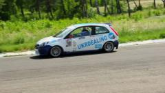 Motor sport car turning on asphalt track, driving high speed, click for HD Stock Footage