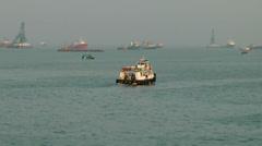 India Maharashtra District Mumbai 060 ferry boat passes by Stock Footage
