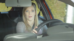 Girl gets scared of somehing and turns the car - stock footage