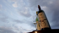 Wine Bottles and Glass time-lapse 1080p. Beautiful clouds at sunset Stock Footage