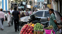 India Maharashtra District Mumbai 048 street scene with a fruit trader Stock Footage